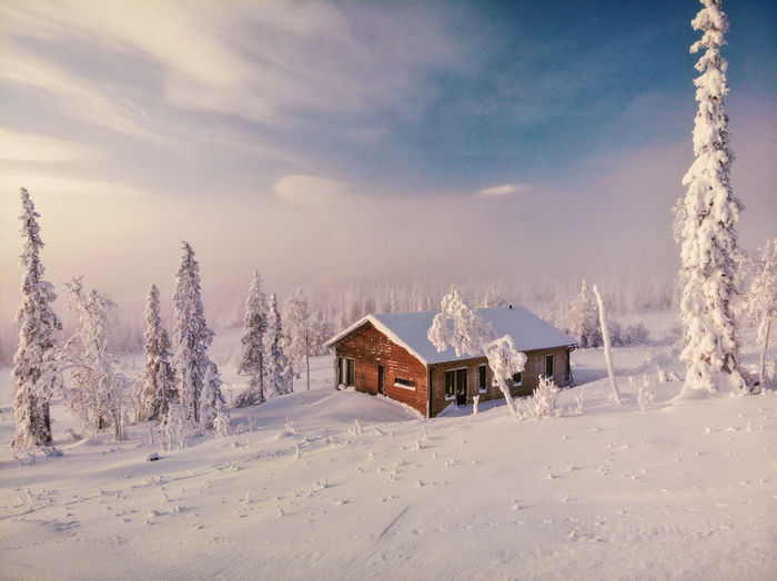cabin in winter landscape EyeEm Selects Cabin Cabin In The Woods Tree Snow Cold Temperature Winter Road Snowing Sky Cloud - Sky Landscape Mountain Range Snowcapped Mountain Foggy Non-urban Scene Remote Snowcapped Mountain Bare Tree Rocky Mountains Tranquil Scene Hiker Scenics Countryside