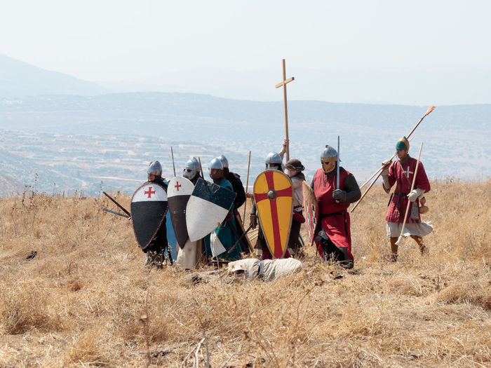 Tiberias, Israel, July 01, 2017 : Participants in the reconstruction of Horns of Hattin battle in 1187 dressed in the costumes of soldiers Saladin go on the attack near Tiberias, Israel Battle Cross Crusaders Field Fire Guy De Lusignan Hattin Heat Heritage History Horn Horseman Infantry Israel Jerusalem KINGDOM Knight  Muslims Palestine Religion Saladin Templars Victory War Weapons