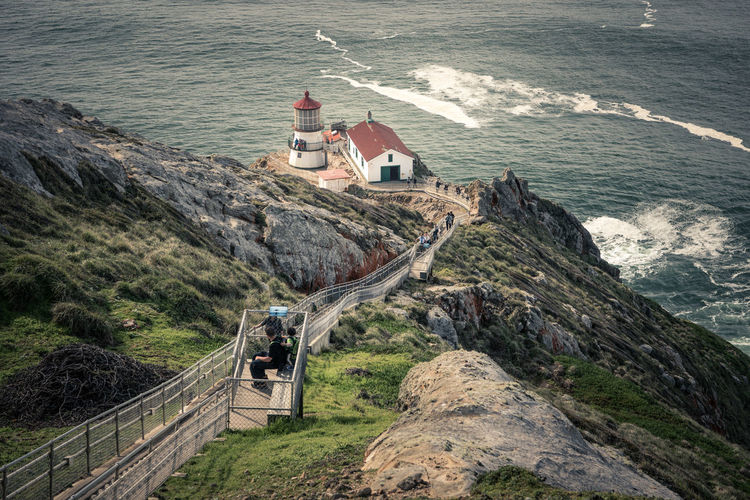 High angle view of lighthouse by sea