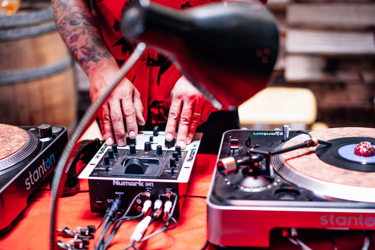 Dj Adult Arts Culture And Entertainment Audio Equipment Club Dj Control Dj Hand Human Body Part Human Hand Men Mixing Music Nightlife Occupation One Person Performance Real People Record Skill  Technology Turntable