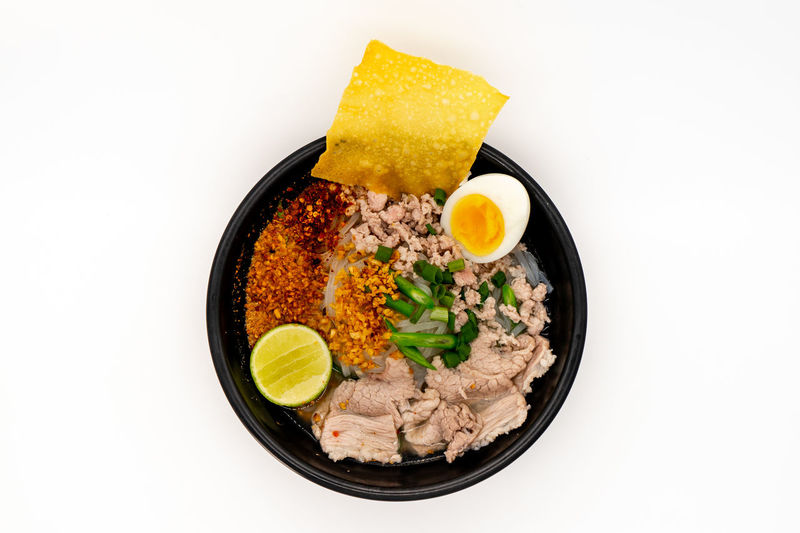 High angle view of food in bowl against white background