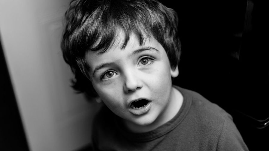 Close-up portrait of shocked boy