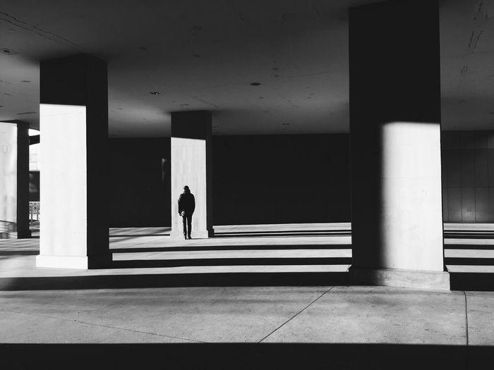 Man walking in parking lot