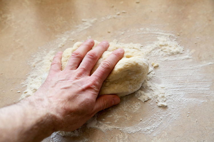 High Angle View Of Hand Of A Bakera