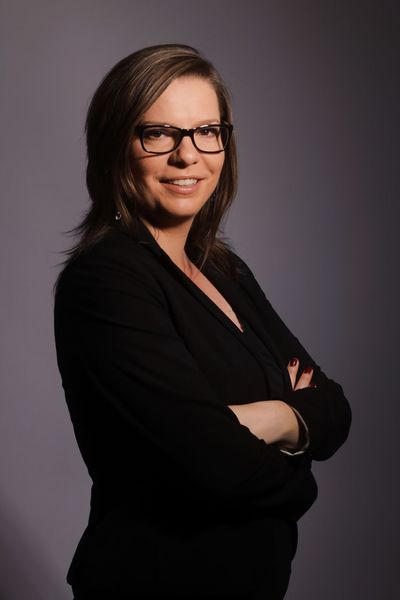 Portrait of a business woman Looking At Camera Portrait Smiling Eyeglasses  Glasses Women One Person Adult Happiness Indoors  Arms Crossed Studio Shot Business Person Hairstyle Businesswoman Standing Hair Young Adult Business Waist Up