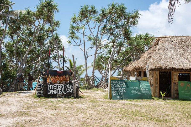 MYSTERY ISLAND, VANUATU, PACIFIC ISLANDS-DECEMBER 2,2016: Thatched roof cottage, funny cannibal soup cauldron and mangrove trees on the uninhabited tropical Mystery Island, Vanuatu Humor Mystery Island Tropical Paradise Vacations Architecture Beauty In Nature Bowl Of Soup Built Structure Cannabalism Cauldron Communication Day Grass Hut Mangrove Nature Pacific Islands Pacific Ocean Shelter Sky Sunlight Thatched Roof Tourism Travel Destinations Tree Vanuatu