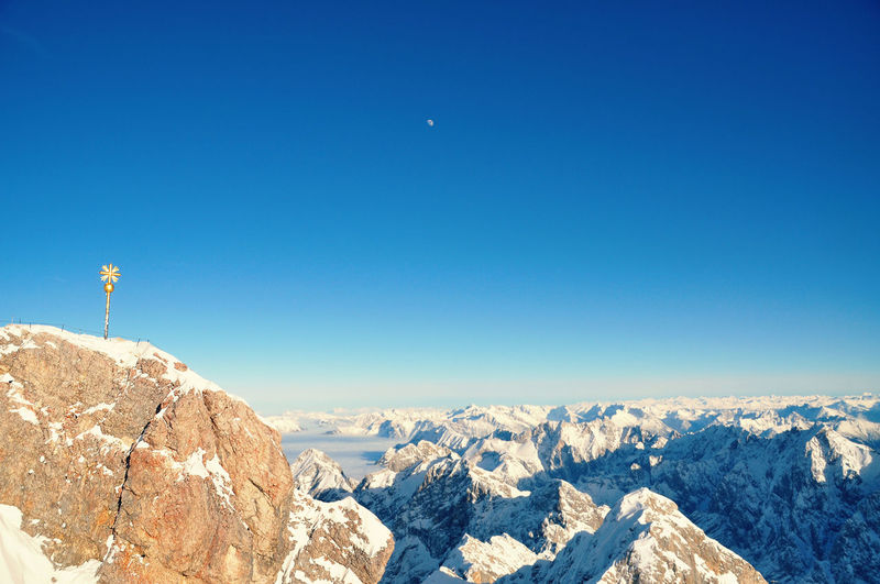 Summit Cross On Zugspitze Mountain Peak Against Clear Sky