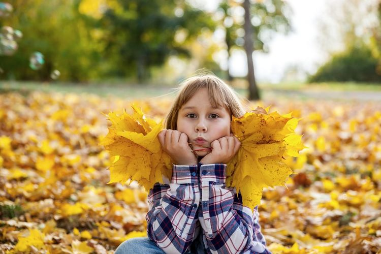 Portrait of girl with yellow leaves