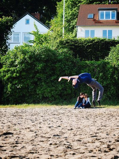Goose Jumps // Hamburg Tree Full Length One Person Front View One Man Only Men Outdoors Day Streetphotography Candid Jumping Love Couple Only Men Adult Young Adult Real People People Architecture Adults Only