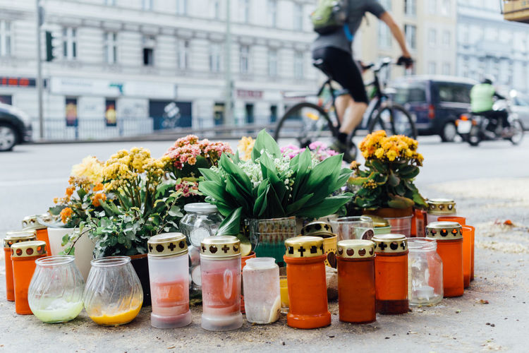 Flowers and candles remembering the victim bike rider killed in a traffic accident in Berlin, Germany Accident Accidental Bike Biking Candle City City Life City Street Conceptual Day Flower Flowers Incidental People Killed Memorial Memories Mourning Outdoors Public Remember Selective Focus Symbol Traffic Traffic Accident Victim