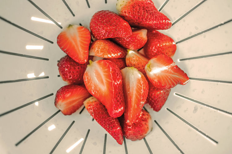High angle view of strawberries in colander