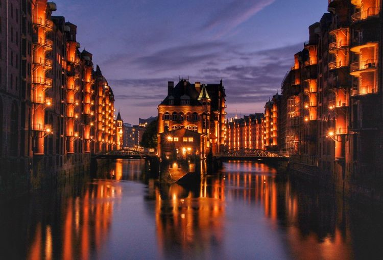 Wasserschloss in der Spiecherstadt, Hamburg Hamburg Speicherstadt Wasserschloss Illuminated Reflection Sky Water Architecture Building Exterior Dusk City Building Built Structure Cloud - Sky Night Connection No People Nature Travel Destinations River Waterfront Sunset Cityscape