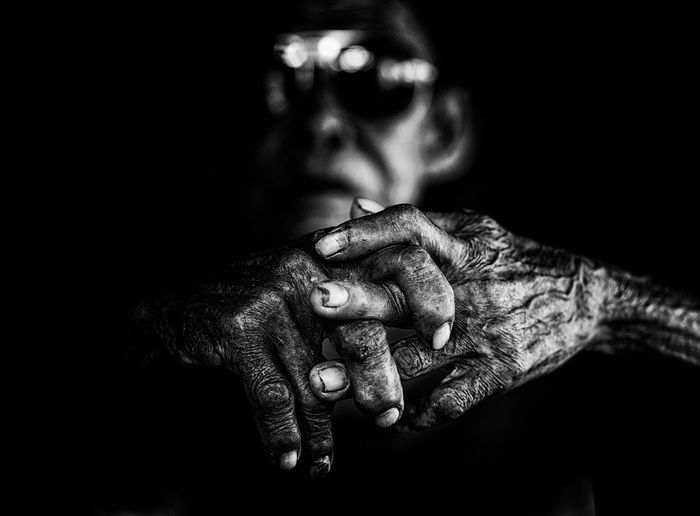 The Potrait of Mr Kasep Black Background Close-up Darkness And Light Focus On Foreground Hands Leisure Activity Lifestyles Oldman Part Of Poorpeople Potrait_photography Selective Focus
