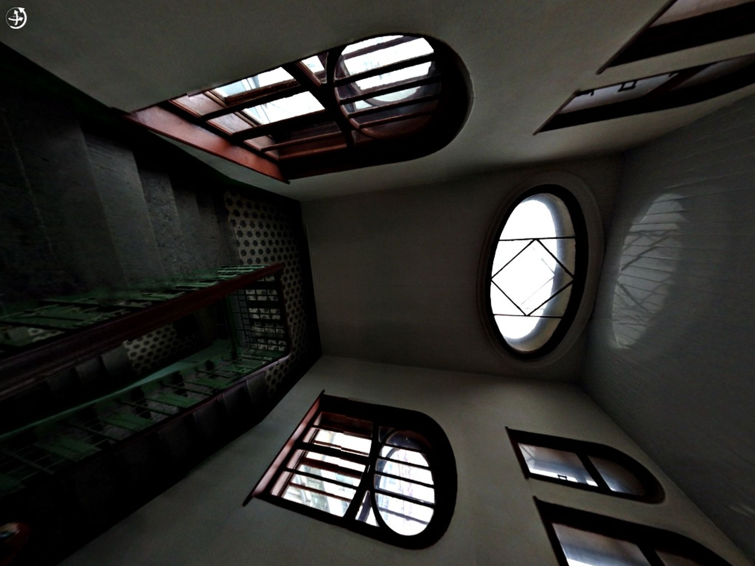 low angle view, architecture, indoors, built structure, window, directly below, building, building exterior, no people, glass - material, skylight, illuminated, clock, ceiling, day, geometric shape, time, pattern, design, architectural feature