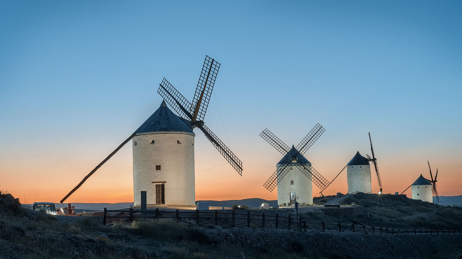 Quixote Windmill Windmills Alternative Energy Architecture Blue Building Exterior Built Structure Clear Sky Environment Environmental Conservation Fuel And Power Generation Industry Landscape Nature No People Orange Color Renewable Energy Sky Sunset Turbine Wind Power Wind Turbine