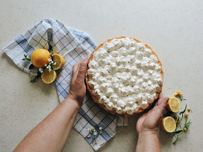 Lemon meringue pie Yellow And Blue Pie Baking Mom's Cooking Lemon Pie Food Composition Food Photography Meringue Lemons Mission Served Food Stories One Person Human Hand Human Body Part Holding People Sweet Food Indoors  Food Dessert Directly Above