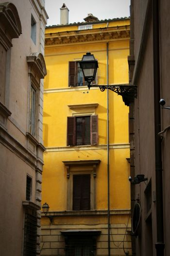 City Yellow Residential Building Façade Window Balcony Architecture Building Exterior Built Structure Shutter