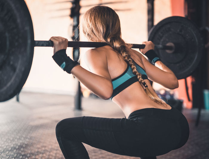 Athlete Athletic Determination Exercising Motivation Squat Squatting Active Lifestyle  Cross Training Crossfit Energy Fitness Fitnessmodel Healthy Lifestyle One Person Real People Sport Sport Clothing Strength Stretching Weight Training  Weightlifting Workout Young Woman Young Women