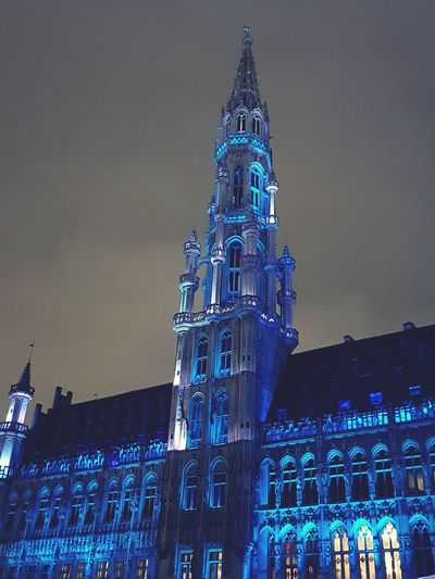 Low angle view of illuminated clock tower against sky