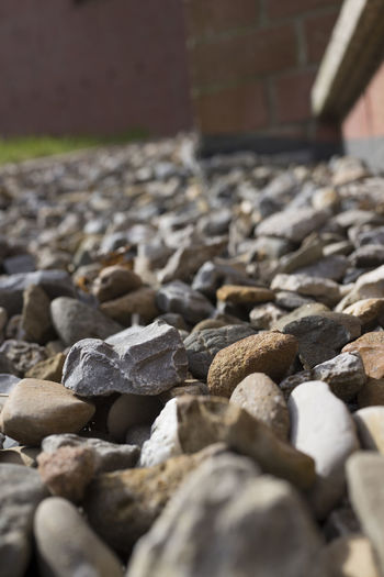 Pebblestones Decor Pebblestones Abundance Architecture Built Structure Close-up Cobblestone Day Decoration Garden Gravel Land Large Group Of Objects Nature No People Outdoors Pebble Rock Rock - Object Rough Selective Focus Solid Stone Stone - Object Stone Material Surface Level Textured