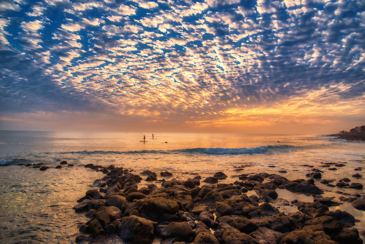 low perspective sea scape at Ngor. Sunset Sky Cloud - Sky Sea Sunset Water Beach Scenics - Nature Beauty In Nature Tranquil Scene Land Nature Tranquility Rock No People Solid Rock - Object Orange Color Horizon Over Water Horizon Outdoors