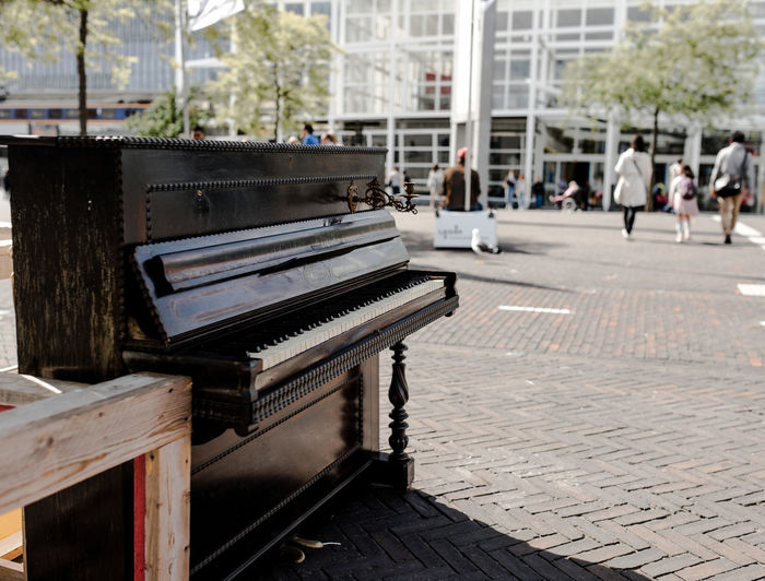 Architecture Arts Culture And Entertainment Building Exterior Built Structure Day Leiden Music Musical Instrument No People Outdoors Piano Piano Piano Moments Street Street Photography Tree Street Music Street Music Day Your Ticket To Europe