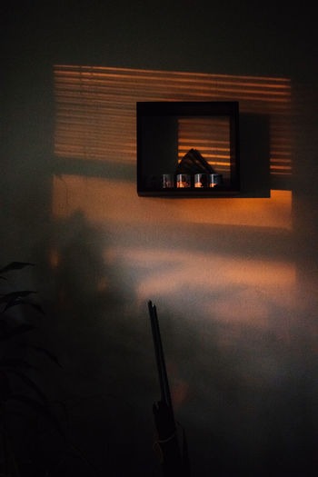 Reflection of building on table at sunset