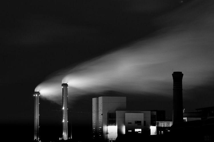 Factory Against Sky At Night