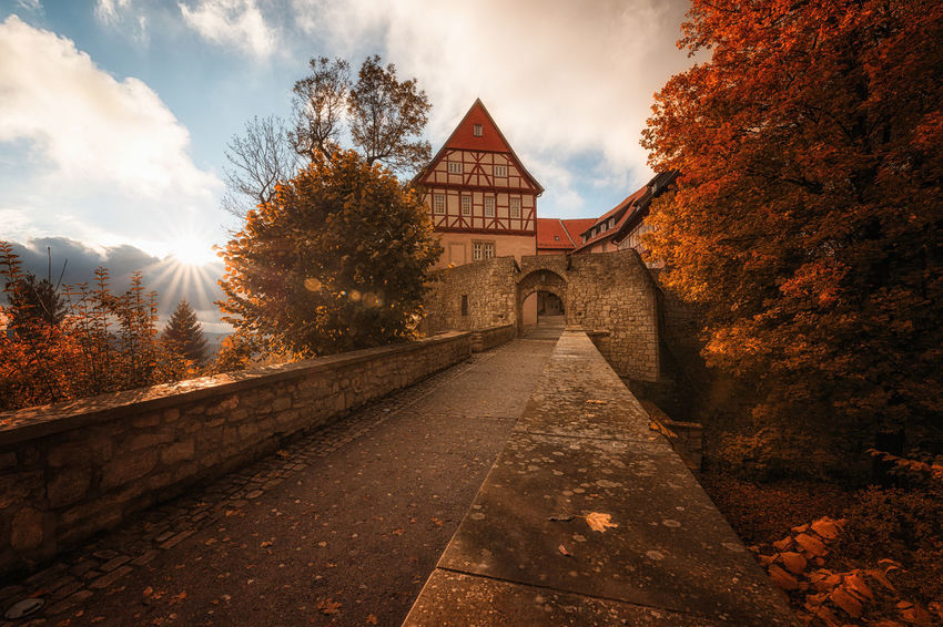 Castle Deutschland EyeEmNewHere Architecture Autumn Building Building Exterior Built Structure Change Cloud - Sky Day Direction Footpath Harz Nature No People Outdoors Place Of Worship Plant Religion Sky The Way Forward Transportation Tree