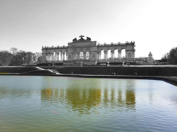 Reflection of historic building in water