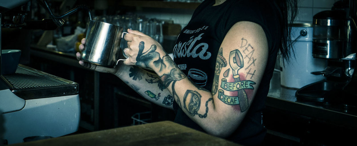 death before decaf Coffee Death Decay Barrista Business Cafe Culture Close-up Coffee Tattoo Creativity Female Focus On Foreground Food And Drink Funky Hand Human Body Part Human Hand Human Limb Indoors  Machinery Milk Jug Occupation Tattoo Technology Text Working