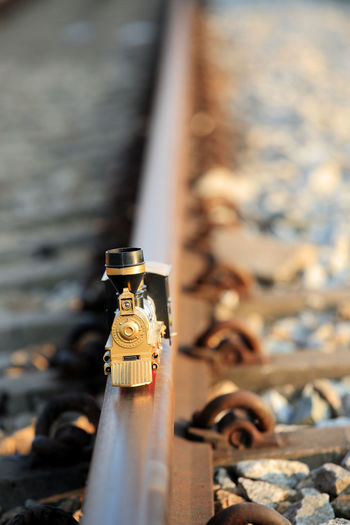 Train toy model on rail . Shallow depth of field composition. Construction Fixie Fun Heavy Tool Iron Labour Models Plastic Toy Platform Play Playground Railroad Track Station Track Transportation Travel Traveling Journey Train Train Station Train Tracks Vintage Train Vintage Photo