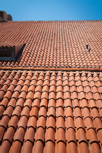 Architecture Blue Brown Building Building Exterior Built Structure Clear Sky Day House In A Row Low Angle View Nature No People Outdoors Pattern Residential District Roof Roof Tile Sky Sunlight
