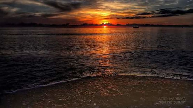 Sunset Sea Reflection Water Beach Scenics Cloud - Sky Horizon Over Water Dramatic Sky Multi Colored Nature Tranquil Scene Sky Tranquility Travel Destinations Beauty In Nature Silhouette Outdoors Horizon Sun