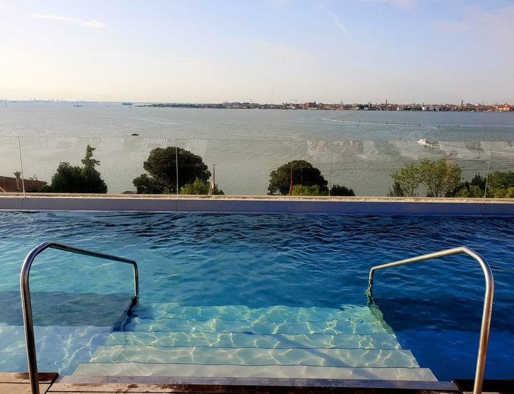 POOL View Bay Beauty In Nature Blue Day Hotel Italy Luxury Nature Outdoors Pool Scenics - Nature Sea Sunlight Swimming Pool Tranquil Scene Tranquility Travel Destinations Venice Water Waterfront