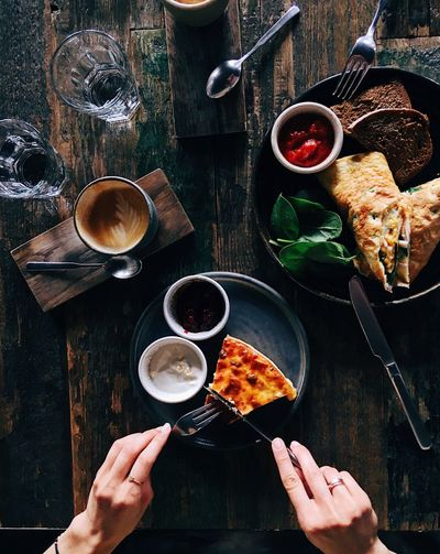 Top view of wooden table with yummy breakfast Healty Food Healthy Lifestyle Eating Wooden Table Pancakes Breackfast Food And Drink Human Hand Hand Food Human Body Part Drink Table Coffee - Drink Directly Above Coffee Cup Coffee Refreshment High Angle View Kitchen Utensil Freshness