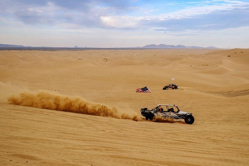 Cars In Desert Against Sky