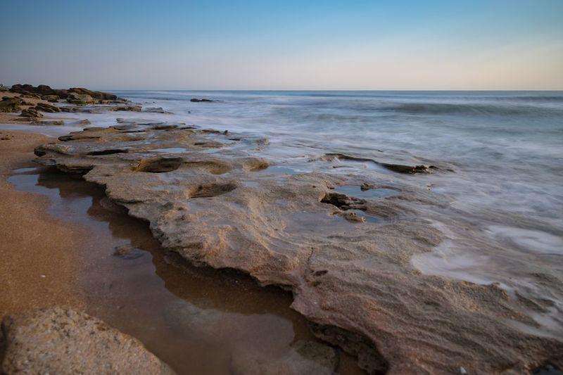 EyeEm Selects Sea Beach Water Sky Land Scenics - Nature Beauty In Nature Horizon Horizon Over Water Tranquility Tranquil Scene Nature Sand Idyllic No People Rock Rock - Object Non-urban Scene Clear Sky Rocky Coastline