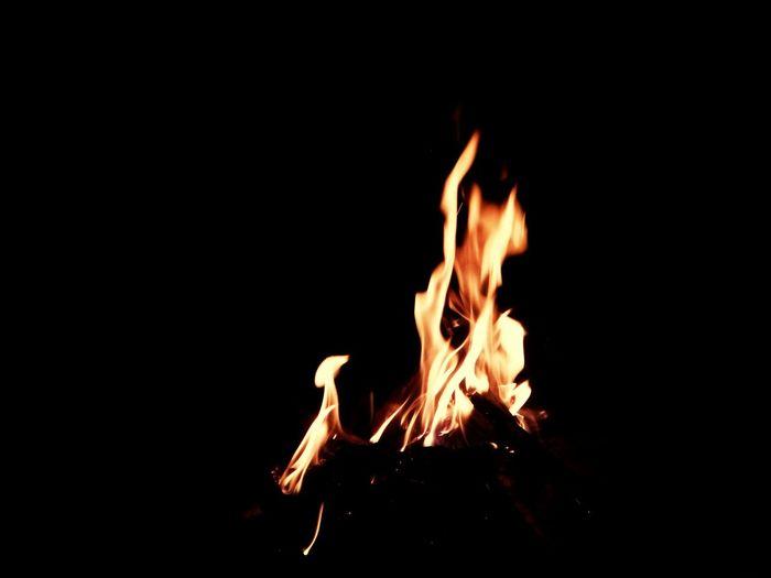 Flame Heat - Temperature Burning Night Black Background Close-up Young Adult Devil Devil Eyes Firewood 31 December 2016 EyeEm Gallery EyeEmBestPics Eyeemphotography EyeEmbestshots