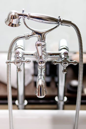 Classic Hot and Cold Showering Faucet Metal No People Close-up Focus On Foreground Indoors  Control Machinery Equipment Silver Colored Shiny Faucet Day Wall - Building Feature Bathroom Still Life Connection Chrome Shower Head Hot And Cold Classic Retro Design