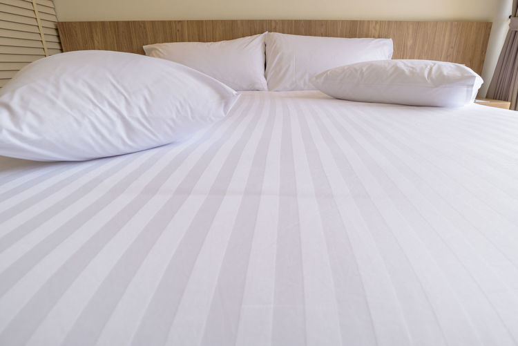 Unmade bed with white pillow and messy Bed Furniture Pillow Bedroom Indoors  Domestic Room Home Interior White Color Linen No People Cushion Sheet Duvet Clean Cozy Relaxation Comfortable Textile Crumpled Empty Headboard Messy Morning Pillowcases Unmade Bed