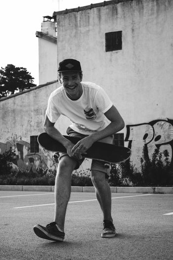 Skateboarding Portrait Sportsman Outdoors Standing Young Men Lifestyles Casual Clothing