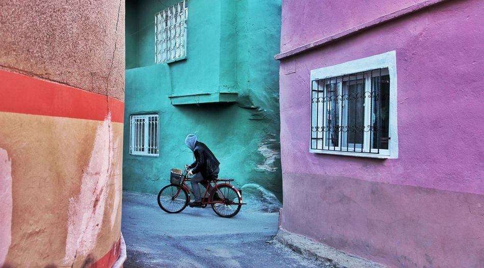 Bicycle on the street between colored walls