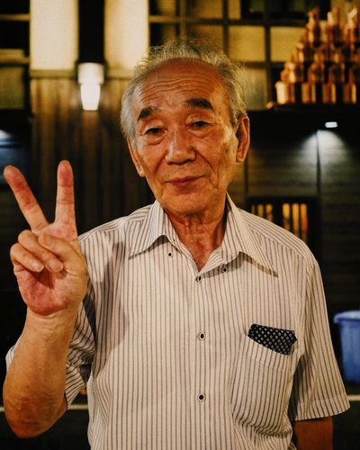 Generous man in Ginza, Tokyo. Ginza Tokyo Japan Japan Peace Tokyo Adult Cheerful Front View Generous Ginza Happiness Looking At Camera One Person People Portrait Real People Senior Adult Senior Men Smiling Tourism