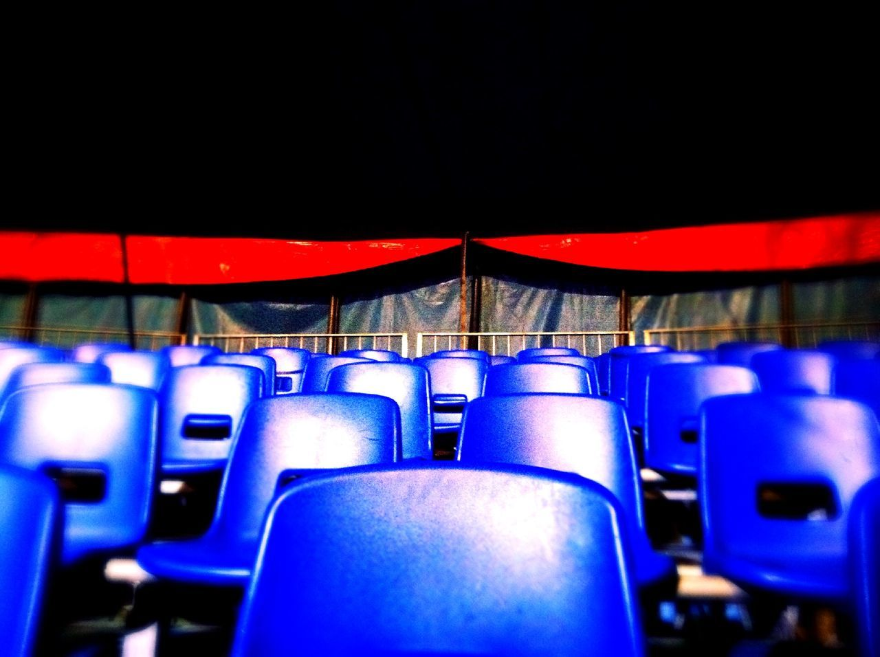 View of blue chairs in auditorium