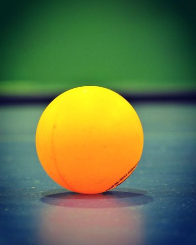 Paint The Town Yellow Ping Pong Ball EyeEm Selects Close-up No People Table Tennis Ball Yellow Table Indoors  Focus On Foreground Single Object Selective Focus Sphere