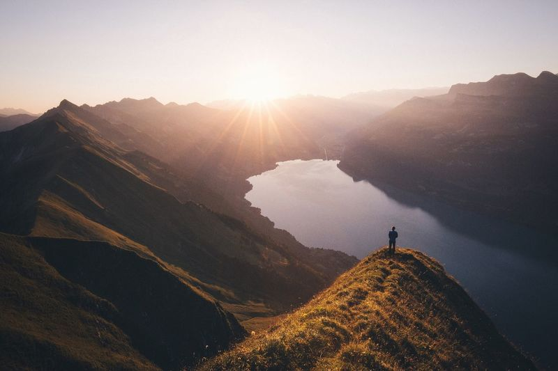 Enjoying the view VSCO Vscofilm Mountain Tranquil Scene Scenics Tranquility Beauty In Nature Tourism Sunbeam Sunset Sunlight Idyllic Travel Destinations Landscape Mountain Range Remote Non-urban Scene Nature Sun Tourist Clear Sky Water
