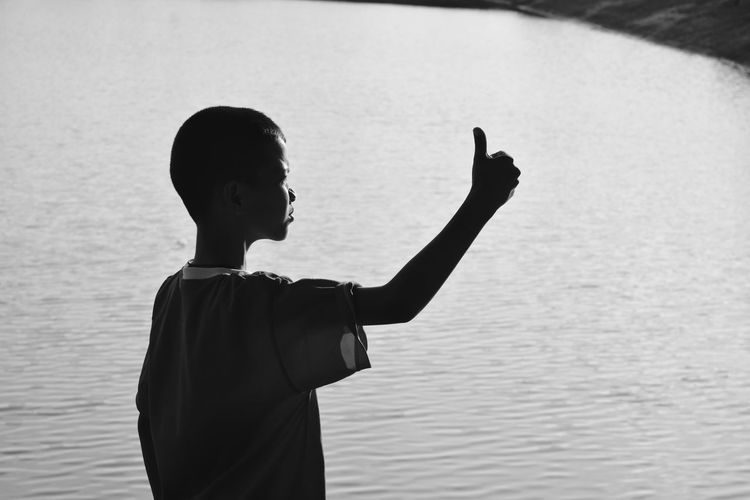 very good EyeEm Selects Beauty In Nature Day Focus On Foreground Gesturing Human Arm Leisure Activity Lifestyles Men Nature One Person Outdoors Real People Rear View Sea Standing Three Quarter Length Waist Up Water EyeEmNewHere