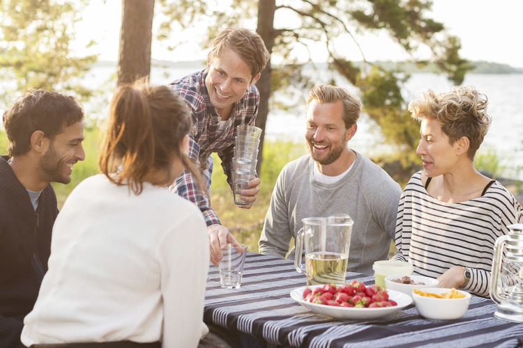 Group of people having food outdoors