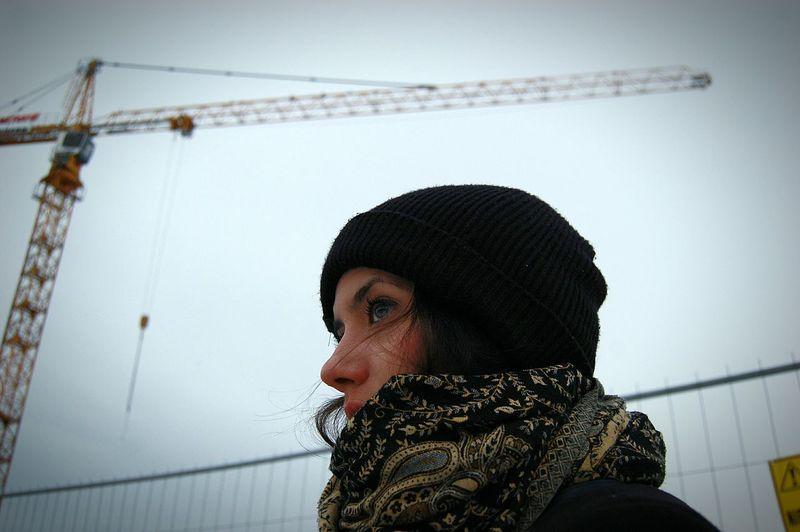 Close-Up Of Woman Against Crane